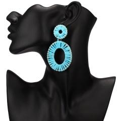 Winding hand-woven raffia geometric stud earrings Blue